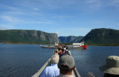 Tourists at Western Brook Pond. WESTERN BROOK POND, CANADA – JULY 19: Tourists heading towards tour boats on July 19, 2011 at Western Brook Pond in Gros Morne Stock Photography