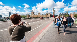 Tourists on Westminster Bridge in London Stock Photo