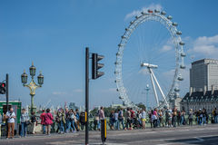 Tourists on Westminster Bridge in London Royalty Free Stock Photography