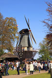 Tourists at the windmill in the Keukenhof flower park, Netherlan Royalty Free Stock Images