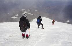 Tourists in a winter mountain Royalty Free Stock Image