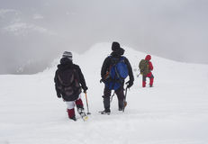 Tourists in a winter mountain Stock Image