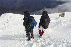 Tourists in a winter mountain Royalty Free Stock Photos