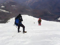 Tourists in a winter mountain Royalty Free Stock Images