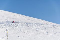 Tourists in the  Winter Mountain. People hiking in a   winter mountain  adventure concept Stock Photo