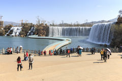 Tourists wisiting the Kunming Waterfall park featuring a 400 meter wide manmade waterfall. Kunming is Yunnan's capital Royalty Free Stock Image