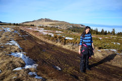 Tourists woman  enjoying the mountain view Stock Image