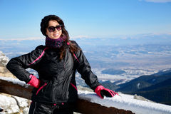 Tourists woman  enjoying the winter mountain view in a ski resort .Bulgaria,Borovets Stock Photography
