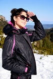 Tourists woman  enjoying the winter mountain view in a ski resort .Bulgaria,Borovets Royalty Free Stock Photos