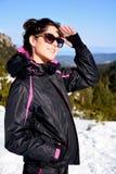 Tourists woman  enjoying the winter mountain view in a ski resort .Bulgaria,Borovets Royalty Free Stock Photos