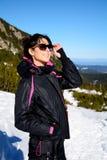 Tourists woman  enjoying the winter mountain view in a ski resort .Bulgaria,Borovets Stock Photos