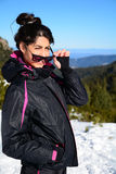 Tourists woman  enjoying the winter mountain view in a ski resort .Bulgaria,Borovets Stock Images
