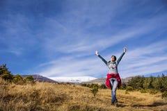 Tourists woman  enjoying the winter mountain view Stock Images