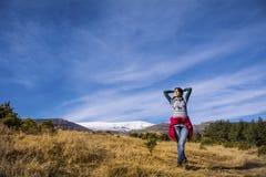 Tourists woman  enjoying the winter mountain view Royalty Free Stock Photo