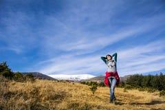 Tourists woman  enjoying the winter mountain view Royalty Free Stock Image