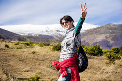 Tourists woman  enjoying the winter mountain view Stock Photo