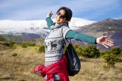 Tourists woman  enjoying the winter mountain view Royalty Free Stock Photos