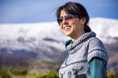 Tourists woman  enjoying the winter mountain view Stock Image