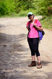 Tourists woman  hiking in the mountain Royalty Free Stock Image
