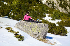 Tourists woman  lying on a stone and enjoying the winter sun Stock Photography