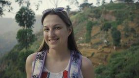 Tourists woman among many tea plantations at sri lanka, happy woman hiker. Asian tourists woman among many tea plantations stock footage