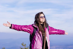 Tourists woman  spreading arms in the mountain Royalty Free Stock Photo