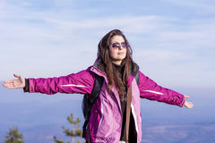 Tourists woman  spreading arms in the mountain Royalty Free Stock Photography