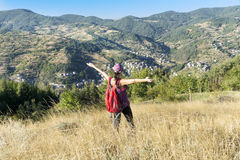Tourists woman spreading arms in the mountain royalty free stock photos