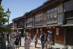 Tourists and women in kimono walking in the historical Higashi Chaya District Royalty Free Stock Photos