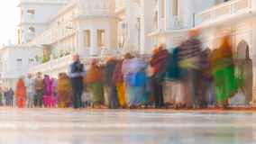 Tourists and worshipper walking inside the Golden Temple complex at Amritsar, Punjab, India, the most sacred icon and worship plac. E of Sikh religion. Blurred Royalty Free Stock Photography