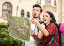 Tourists. Young happy tourists is sightseeing city with map Royalty Free Stock Photo