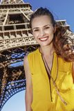 Happy woman against Eiffel tower in Paris, France Royalty Free Stock Images