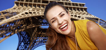 Portrait of happy young woman in front of Eiffel tower in Paris Royalty Free Stock Image