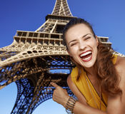 Happy woman pointing on Eiffel tower in Paris, France Royalty Free Stock Images