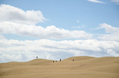 Tourits silhouettes in the desert Stock Photo