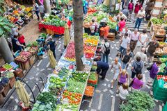 Tourits visiting the vegetable market Mercado dos Lavradores at Funchal, Madeira Island Royalty Free Stock Image