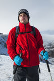 Touritst hiker on cold weather. Trekking in Carpathian mountains (Romania) in winter time with professional equipment and big backpack stock photography