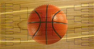 Tournament of 64 Basketball Bracket. Tournament of 64 bracket with basketball on wooden court background Stock Images
