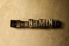 TOURNAMENT - close-up of grungy vintage typeset word on metal backdrop Royalty Free Stock Images