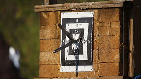 Tournament throwing knives at targets stock video