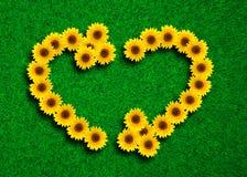 Tournesols dans la forme du coeur et du symbole de réutilisation Image stock