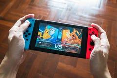 Tournoi DX de Pokken sur le commutateur de Nintendo images stock