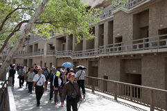 Tours in the Mogao cave. S World Heritage Site, Dunhuang, Gansu Province, China Stock Photo