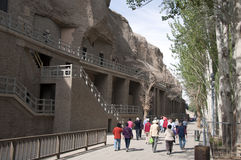 Tours in the Mogao caves. World Heritage Site, Dunhuang, Gansu Province, China Stock Photography
