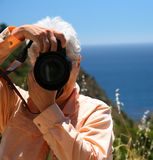 Toursist with Camera. Tourist with Camera at Ocean stock images