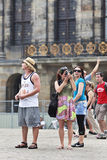 Toursist on Dam Square, Amsterdam. AMSTERDAM-AUG. 19, 2012. Tourists on Aug. 19 in Amsterdam. In 2010 Amsterdam attracted 5.3 million tourist arrivals, good for Stock Photo