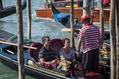 Toursists on gondola Stock Photo