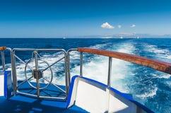 Toursit ship leaving. Tourist ship leaving a Greek island Stock Photos