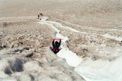 Toursits sliding on Volcano, Chile Stock Image