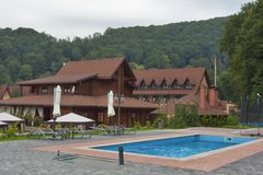 Tourustic complex with outdoor swimming pool in Carpathians Royalty Free Stock Images